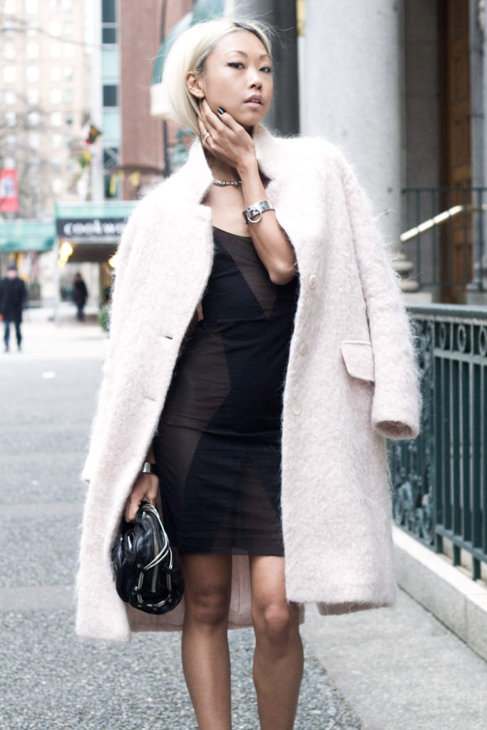 How To Wear Pastel For Winter: Vanessa Hong is wearing a pale pink fluffy coat from H&M Trend