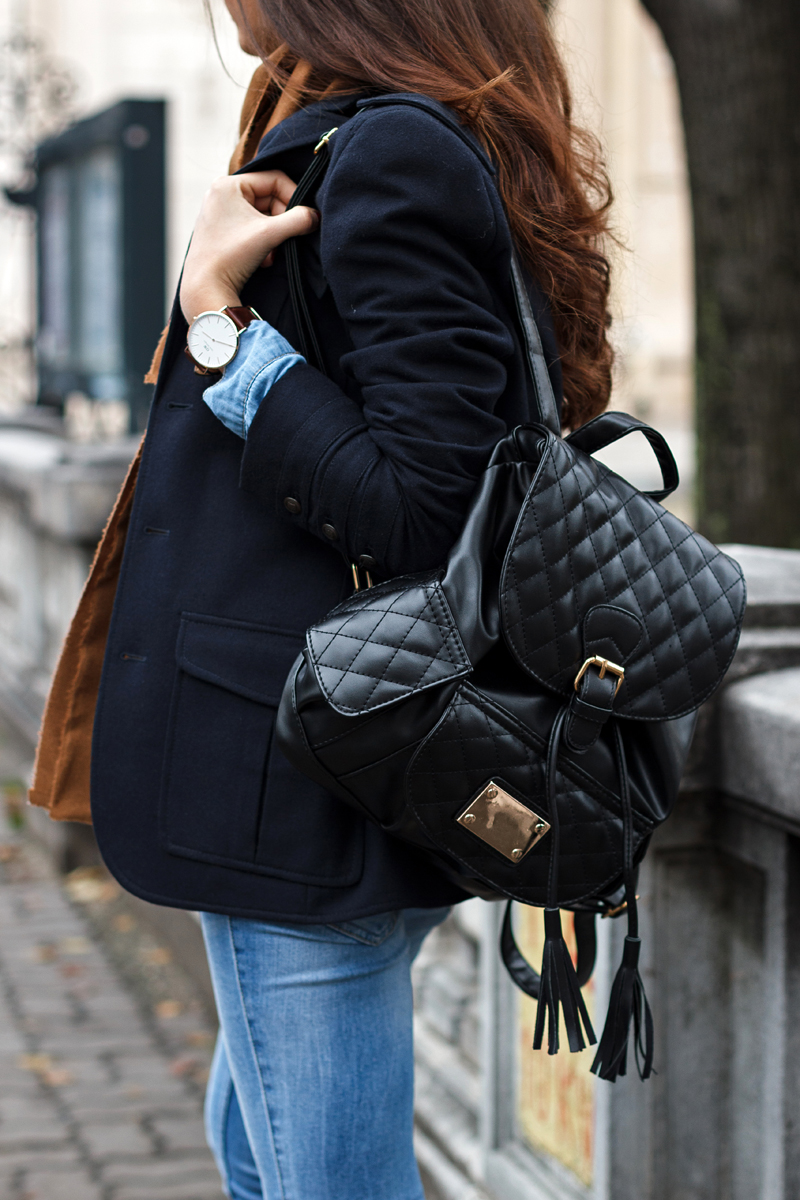 Larisa Costea is wearing a quilted leather backpack from Jadu