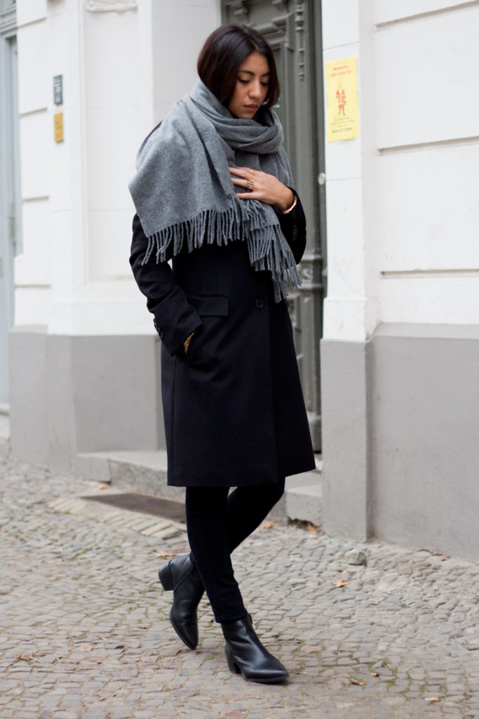 Kayla Seah is wearing a grey oversized scarf from Acne