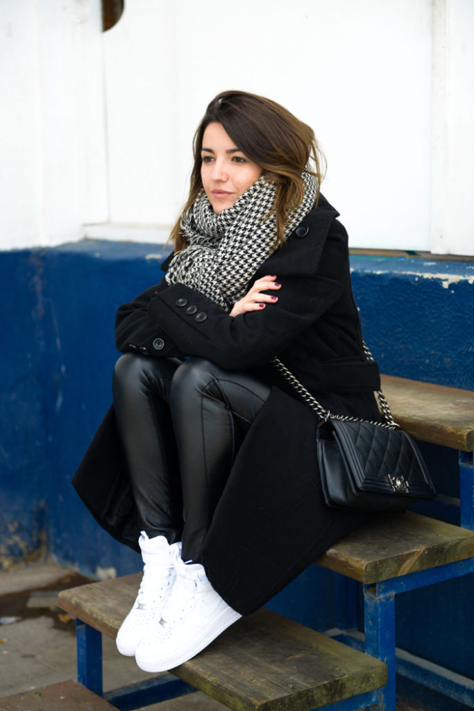 Alexandra Pereira is wearing an oversized houndstooth print scarf