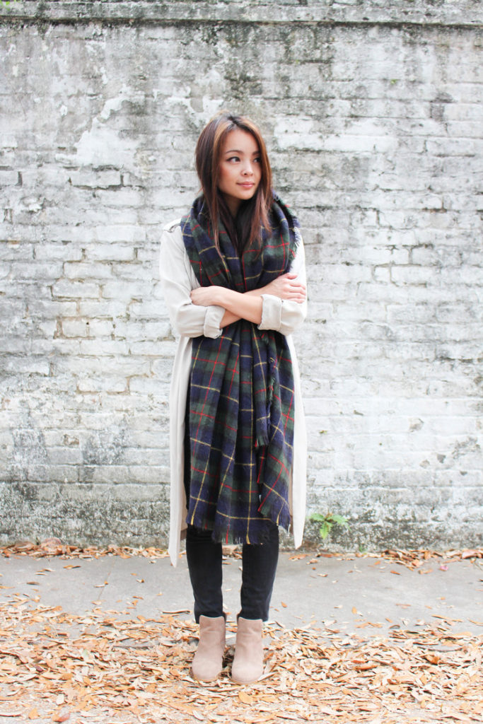 Juley Le is wearing a blue and green plaid oversized scarf from Zara