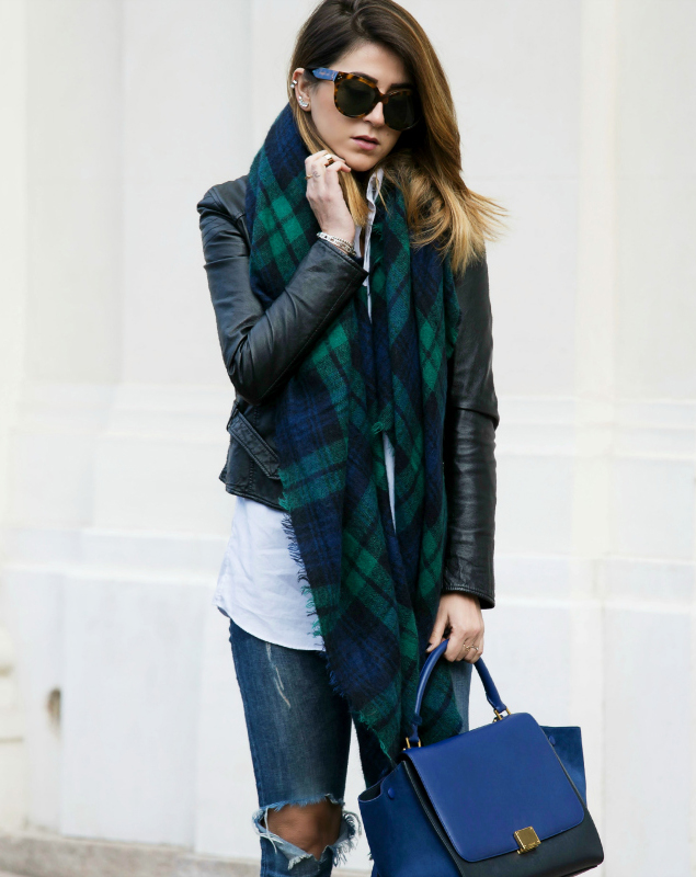 Nicoletta Reggio is wearing a maxi blue and green tartan scarf from Zara