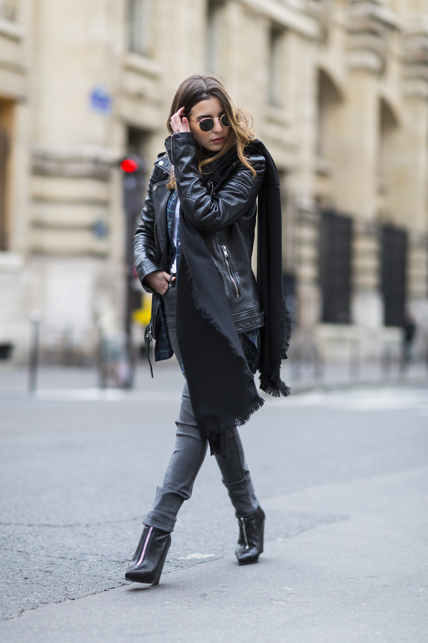 Sarah Naits is wearing a black oversized scarf from Tibi