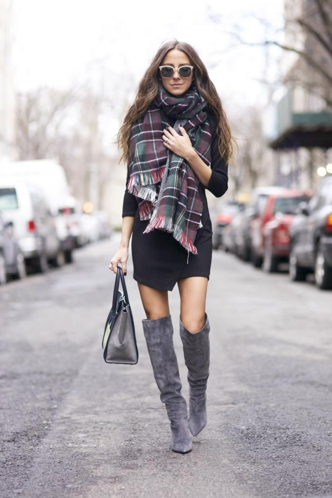 Arielle Nachami is wearing an oversized plaid scarf from Nasty Gal