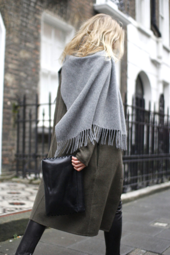 Lucy Williams is wearing a grey oversized scarf from Acne Studios