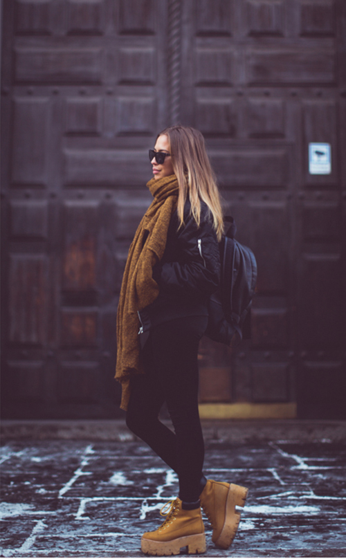 Kenza Zouiten is wearing a tobacco coloured oversized knit scarf from Asos