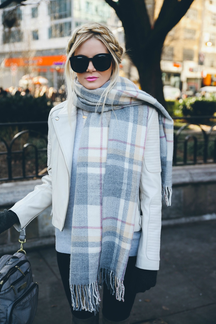 Amber Fillerup Clark is wearing an oversized grey check with tassels from Asos