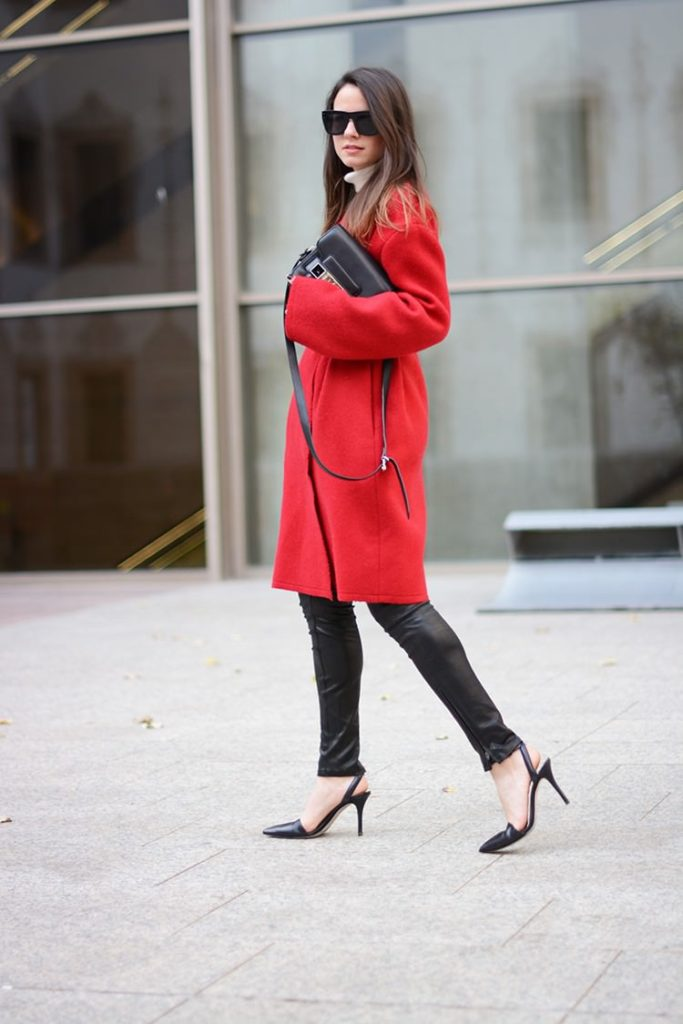 Zina Charkoplia is wearing a red coat from Lanvin