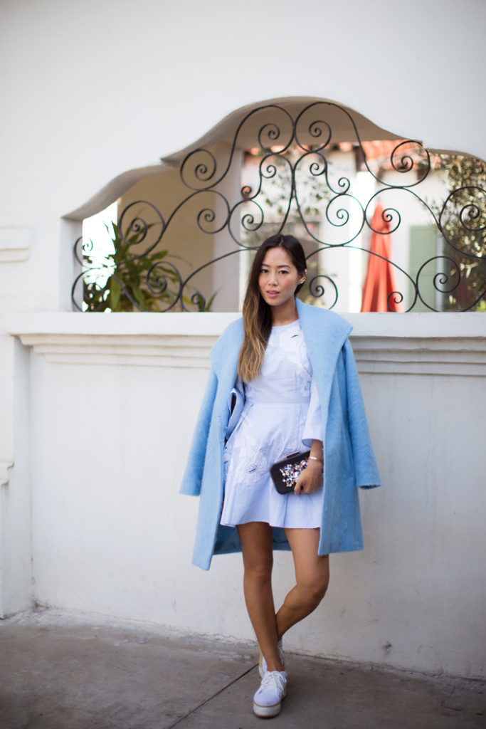 Aimee Song is wearing a baby blue oversized wool coat from French Connection
