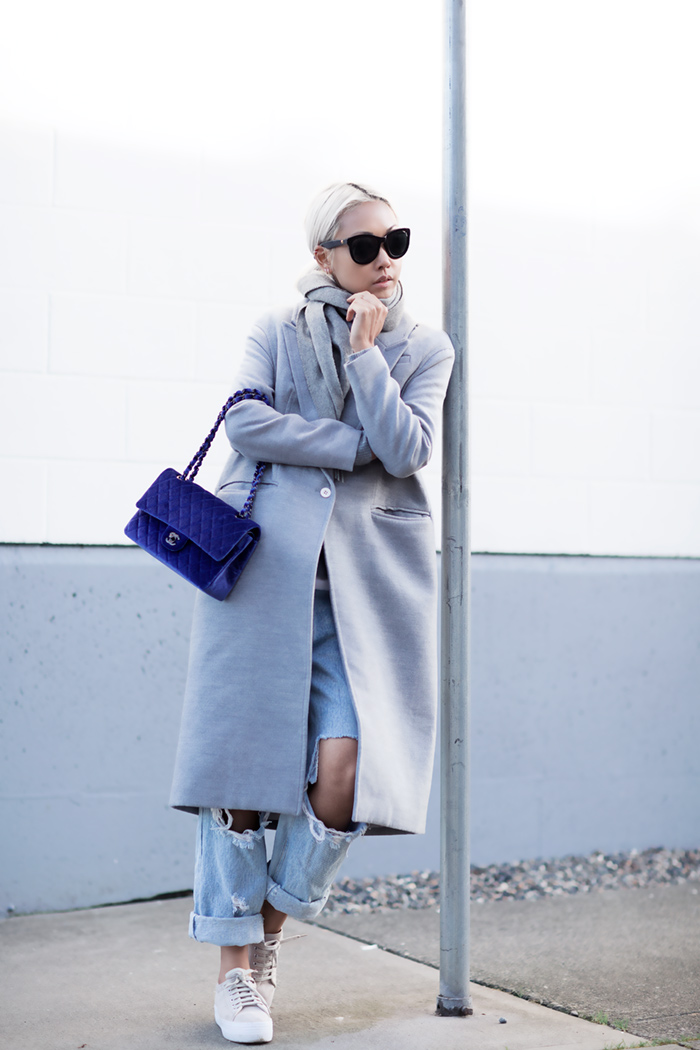 Vanessa Hong is wearing a blue tinge grey coat from Cameo