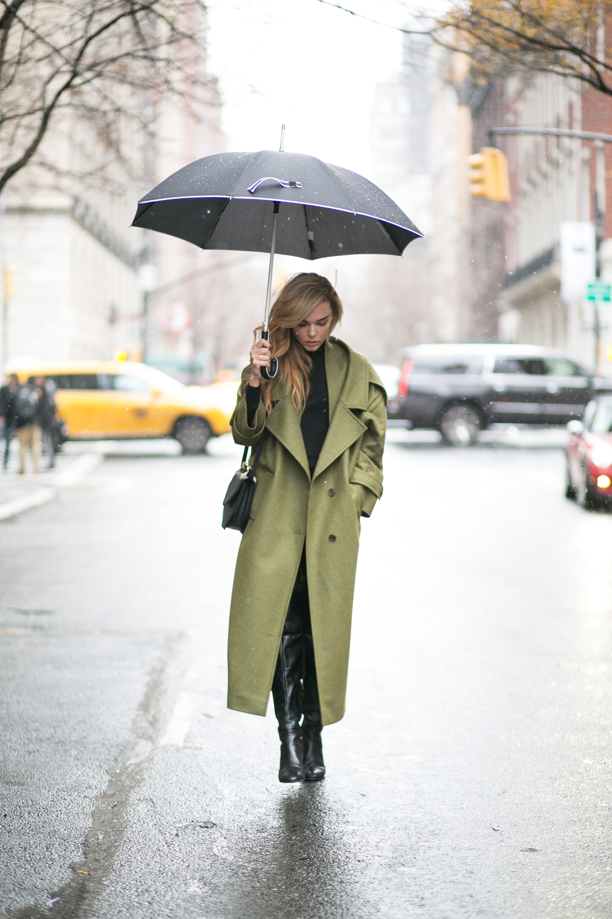 Coats Trend 2015: Evangelie Smyrniotaki is wearing an oversized green coat from Preen by Thornton Bregazzi