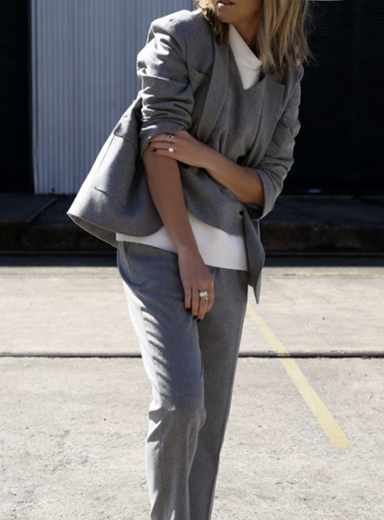 Mandy Shadforth is absolutely rocking this androgynous grey on grey suit, paired with a white tee and a matching grey cashmere sweater. Feminise this outfit with simple silver jewellery like Mandy if you want that sophisticated vibe. Jacket/Trousers: MCQ Alexander McQueen, Shirt: MGSM.