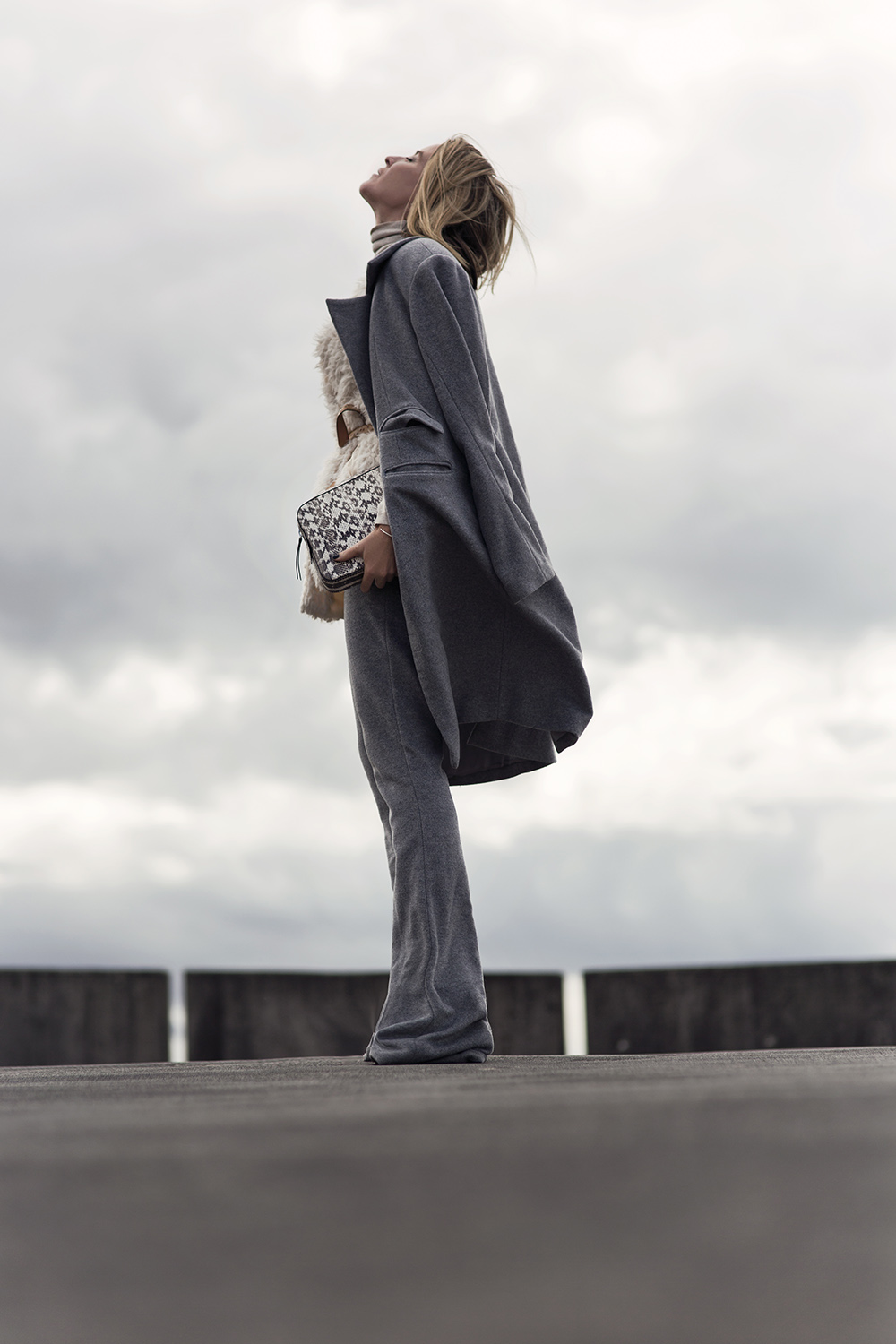 A matching coat and trousers combo will always afford you with an elegant and collected style. Mandy Shadforth looks ultra suave in this double grey outfit, paired with an Aztec style printed clutch for added glam. Coat/Trousers: Anna Quan, Sweater: Rachel Pally.