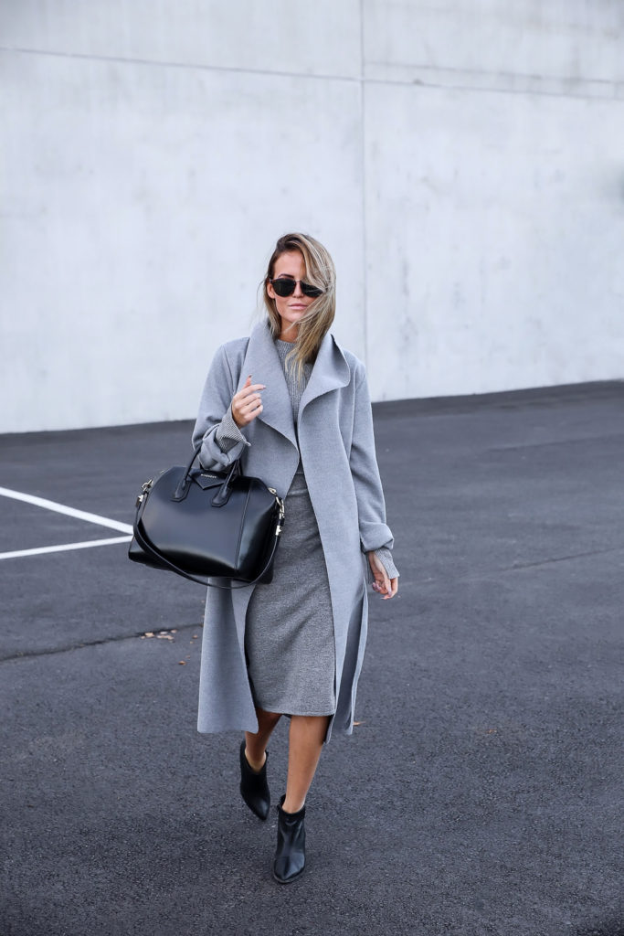 Kristin Sundberg wears a grey sweater dress matched with a grey overcoat.   Skirt: Lindex, Top: Gina tricot, Coat: Misspap, Boots: H&M.