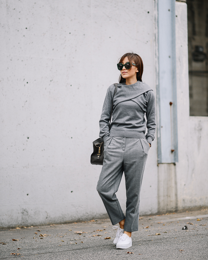 Try pairing casual grey wide leg slacks with a matching knit sweater and swanky white platform flats in your all grey outfit this fall. Via Diana Z Wang.   Sweater: J.W Anderson, Trousers: Topshop, Sneakers: H&M.
