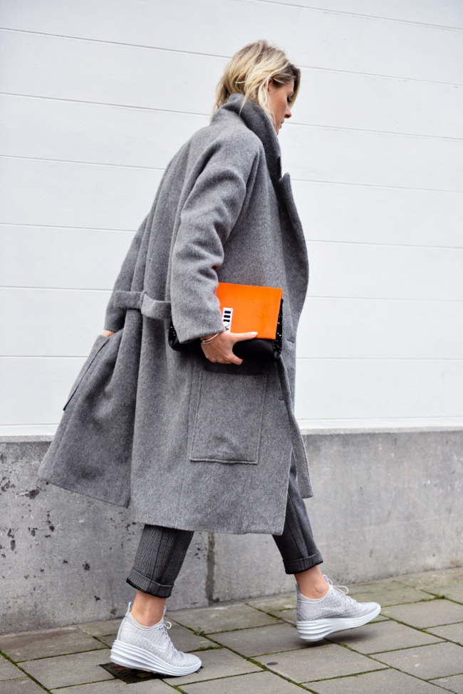 Oversized Grey Coat: Sofie Valkiers is wearing a grey coat from Filles a Papa, trousers from 3.1 Phillip Lim, sneakers from Nike and the bag is from Proenza Schouler