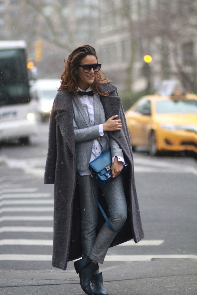 Grey Pants Outfit: Tamara Kalinic is wearing all grey, boots from Lacoste, suit from Sandro, great coat from River Island and the bag is from Proenza Schouler