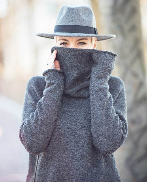Grey Sweater Outfit: Marie Ullevoldsater is wearing all grey, sweater from Lindex and the hat is from H&M