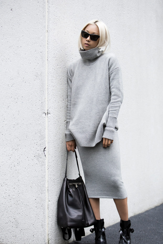 Vanessa Hong is wearing a grey knit turtleneck and skirt from Whistles, backpack from the The Row and the boots are from Zara