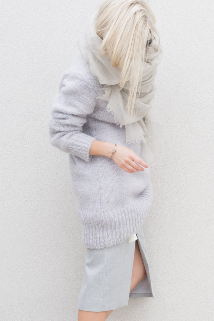 Figtny is wearing a slit skirt from Jax, and a grey knit sweater from Prony and grey cashmere scarf from Helmut Lang
