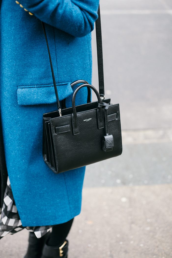 Jacey Duprie is wearing a black Saint Laurent mini bag