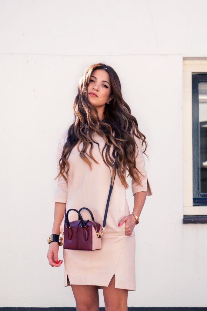 The featured photo is of Negin Mirsalehi wearing her mini bag from Tod's D'Cube