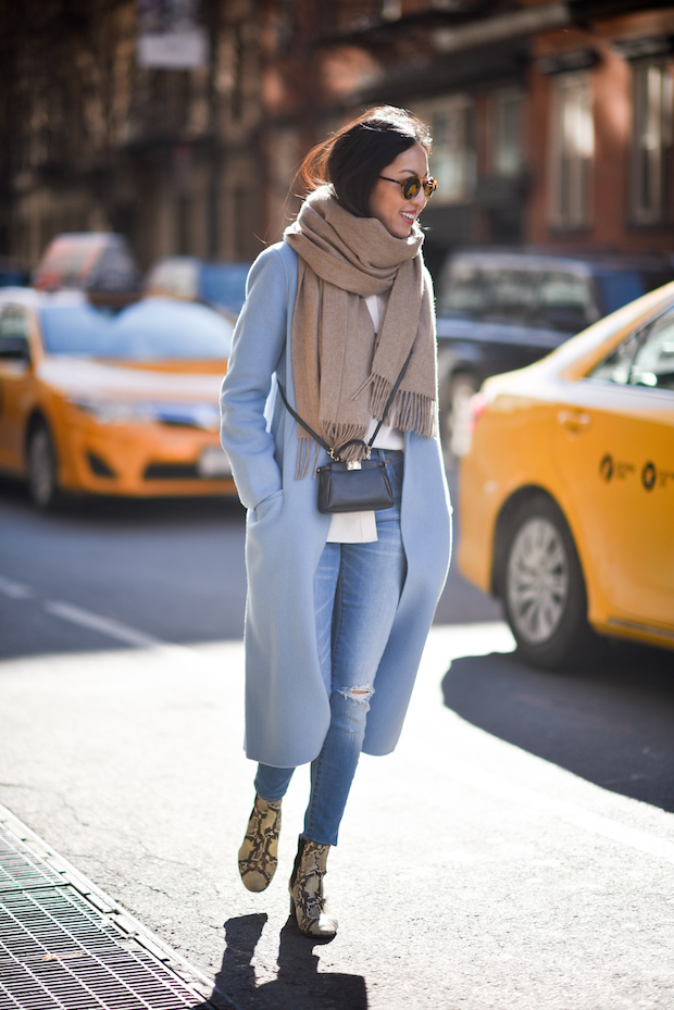 Pastel colours are the perfect choice for a casual and bright winter look. Ann Taylor wears a happy shade of baby blue on a maxi coat and skinny jeans, paired with faux snakeskin boots and shades. Coat: Mute by JL, Blouse/Boots: Isabel Marant Etoile, Turtleneck: Uniqlo, Jeans: Madewell, Scarf: Everlane.