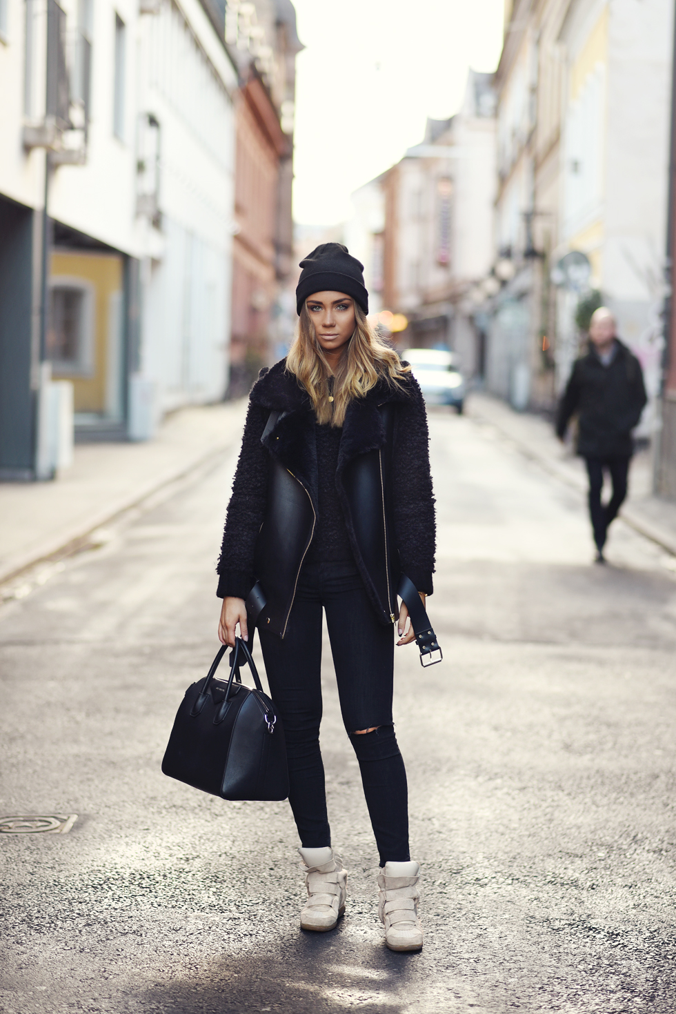 Womens Shearling Coat Trend: Shearling Coat: Lisa Olsson is wearing a shearling collar leather vest from LXLS