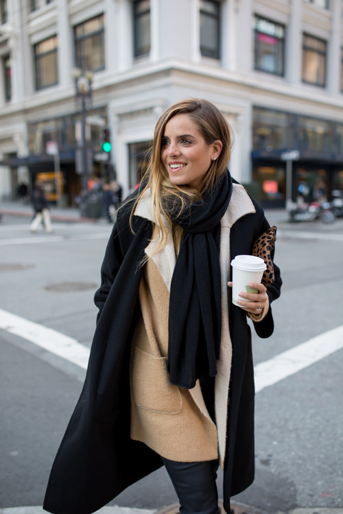 Julia Engel is wearing a belted reversible shearling coat from Max Mara