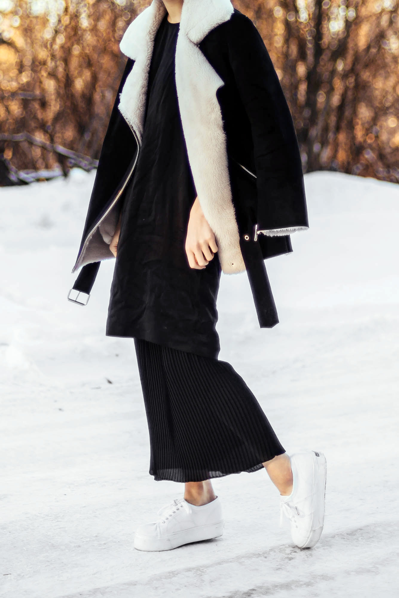 Shearling Coat Trend: Alyssa Lau is wearing a shearling coat