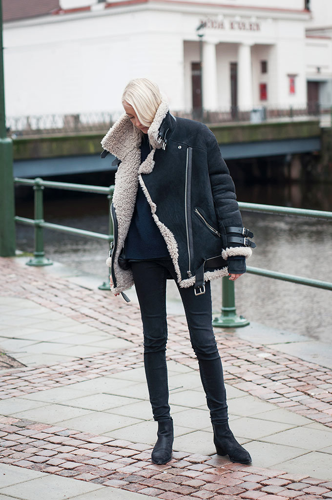 Ellen Claesson is wearing a women's black shearling coat from Acne