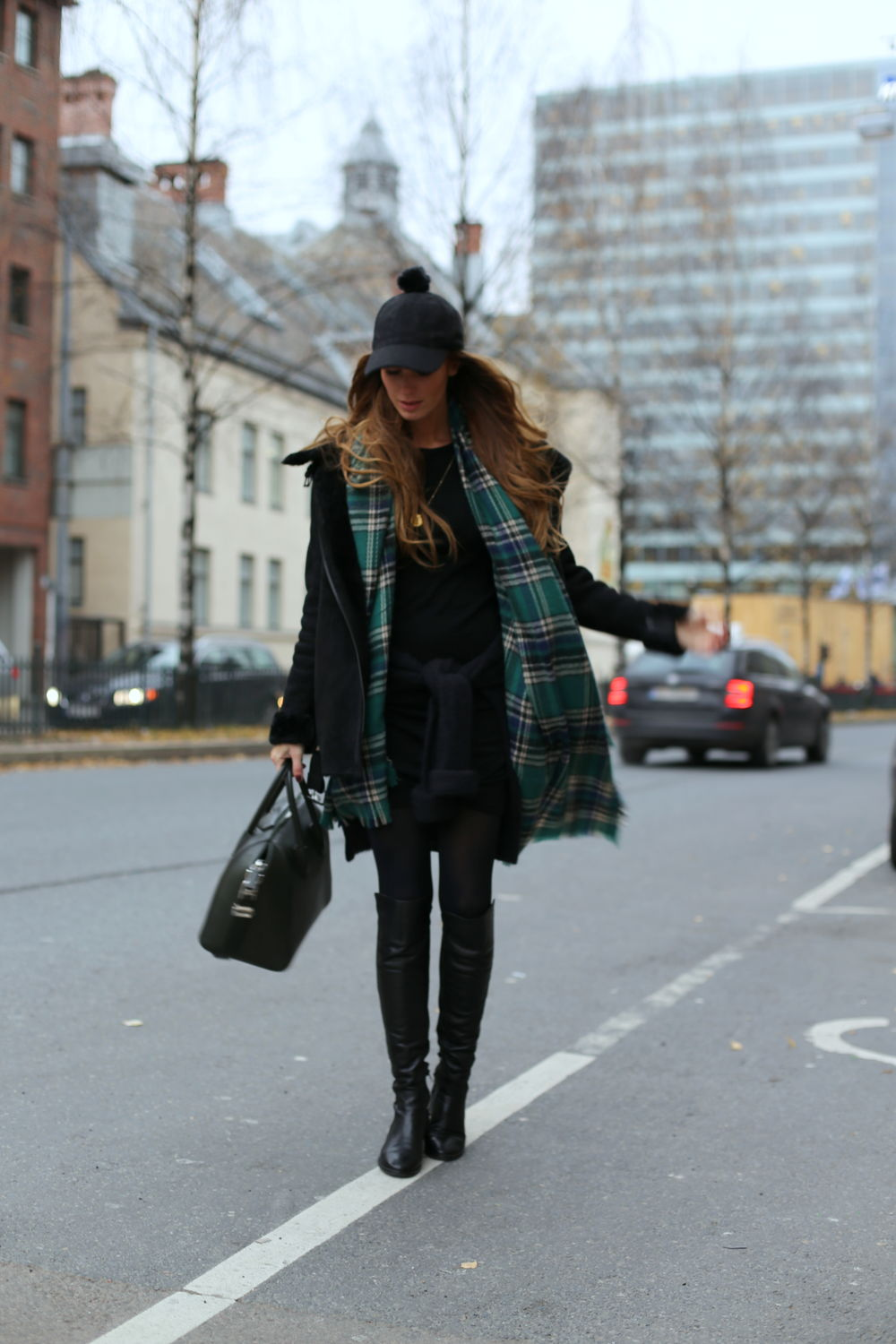 Benedichte is wearing a black coat and jumper from Just Female, skirt from from Woolland, scarf and hat from BikBok and the bag is from Givenchy
