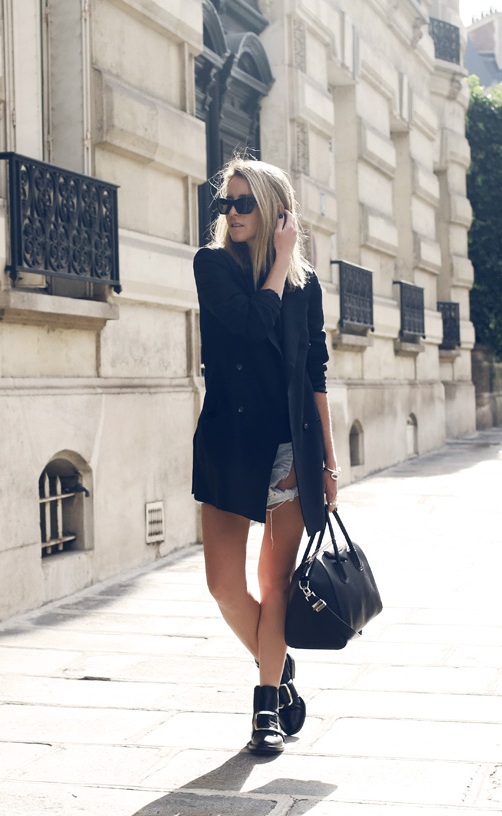 Mandy Shadforth is wearing a black blazer from Alexander McQueen, denim shorts from One Teaspoon and bag and boots from Givenchy