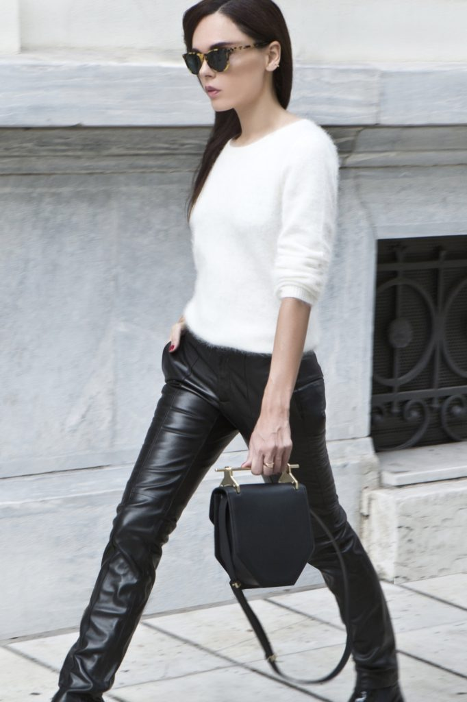 Evangelie Smyrniotaki is wearing leather trousers from Gucci, white fluffy angora jumper and the bag is a M2 Malletier