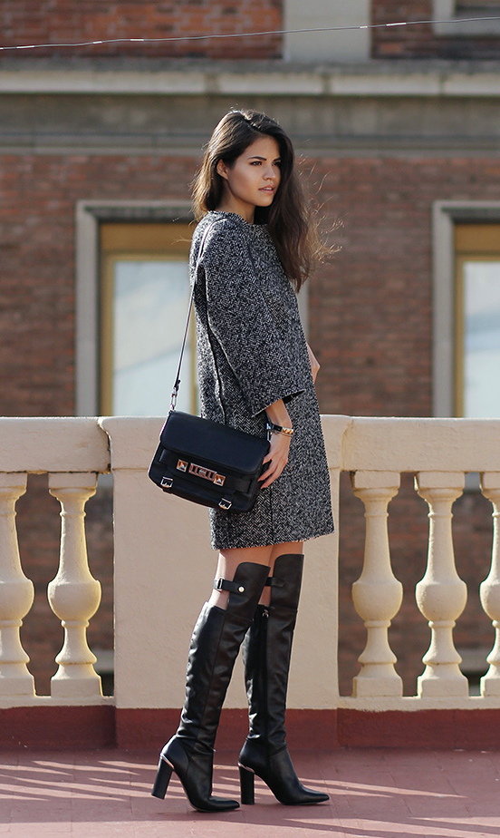 Street Style 2014: Adriana Gastélum is wearing a salt and pepper coat from Rinascimento, black over the knee boots from Reiss and the bag is from Proenza Schouler