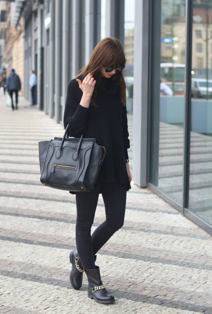 Barbora Ondrackova is wearing a black turtleneck sweater from American Apparel, skinny jeans and chain boots from Beatriceb and the bag is from Celine