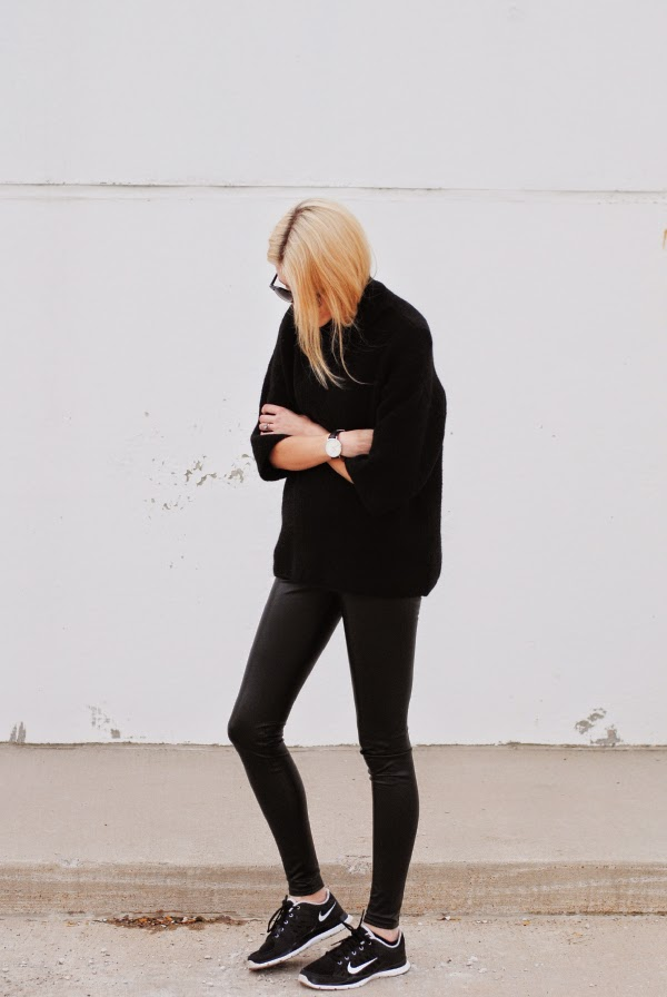 Blaire Badge is wearing a black turtleneck sweater from Zara, leggings from Wilfred Free and the sneakers are from Nike