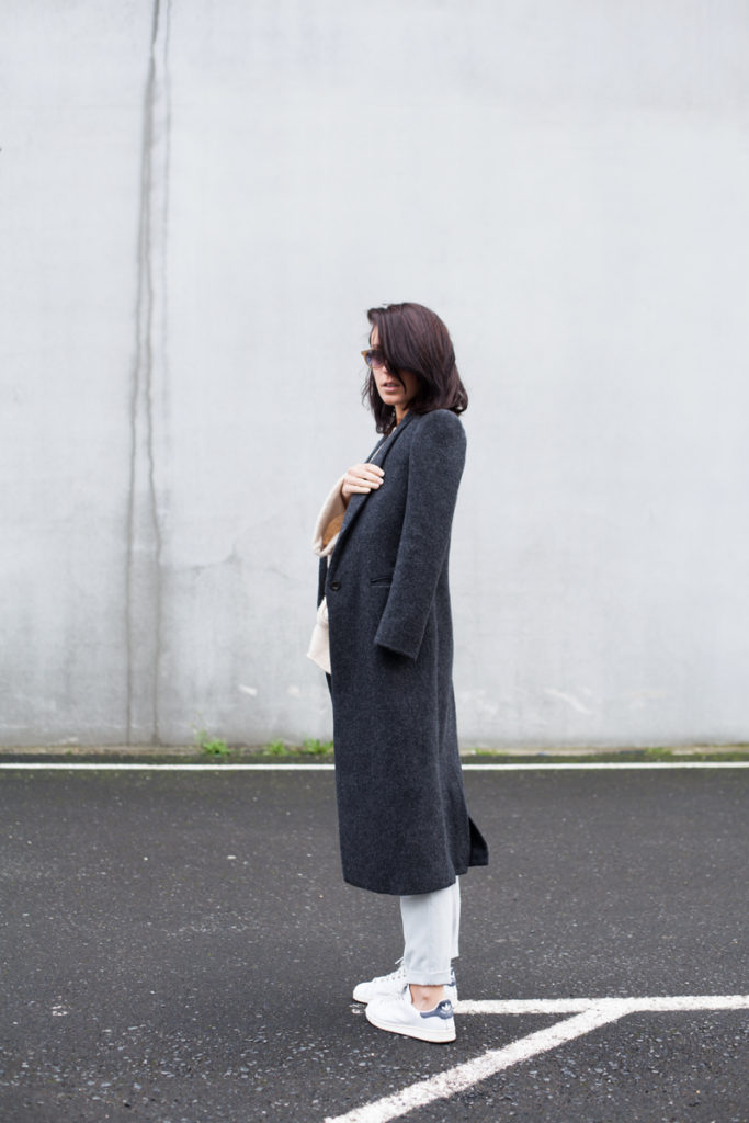 Lucita Yañez is wearing a charcoal coat from Pull&Bear and the shoes are from Adidas