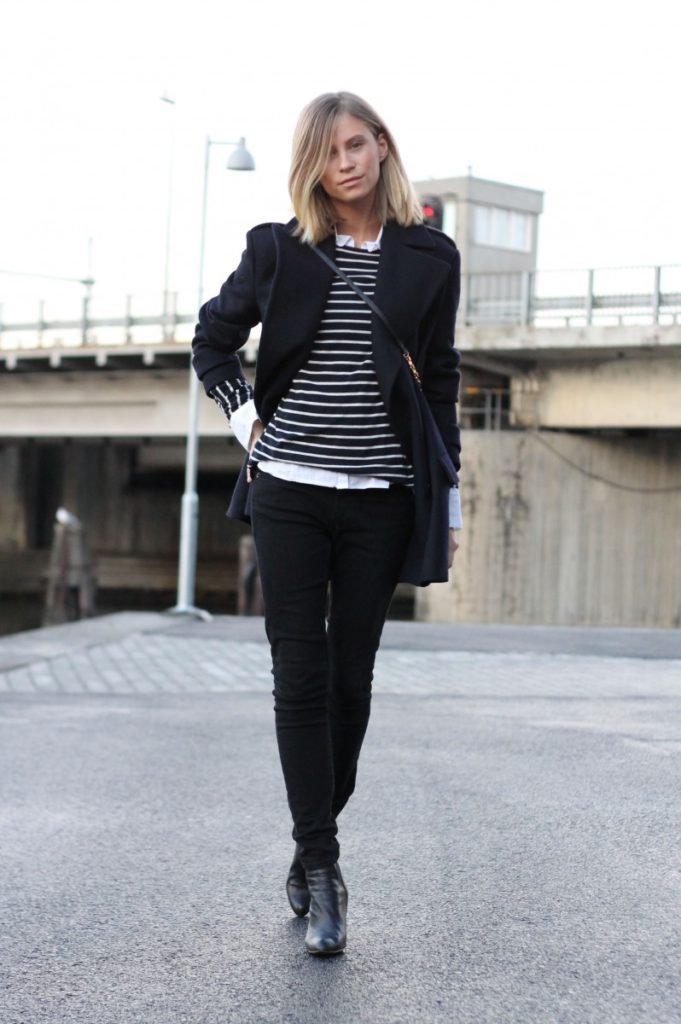 Tine Andrea is wearing black jeans and striped sweater from Weekday, shoes and black jacket from Zara, white shirt from Gant, and the bag is from Marc by Marc Jacobs