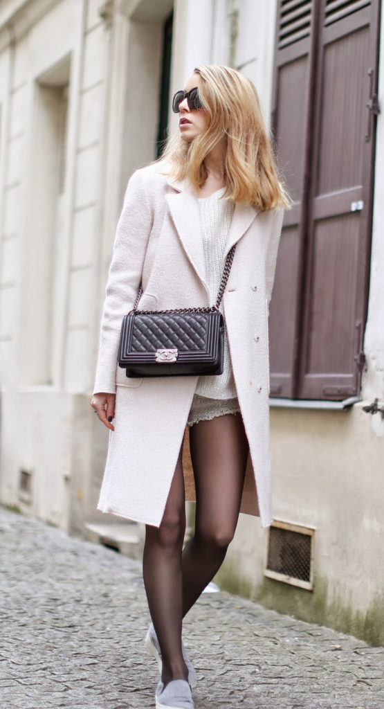 Caroline Louis is wearing a coat and sweater from Zara, shorts from Iro, slip-ons from Céline and the bag is from Chanel