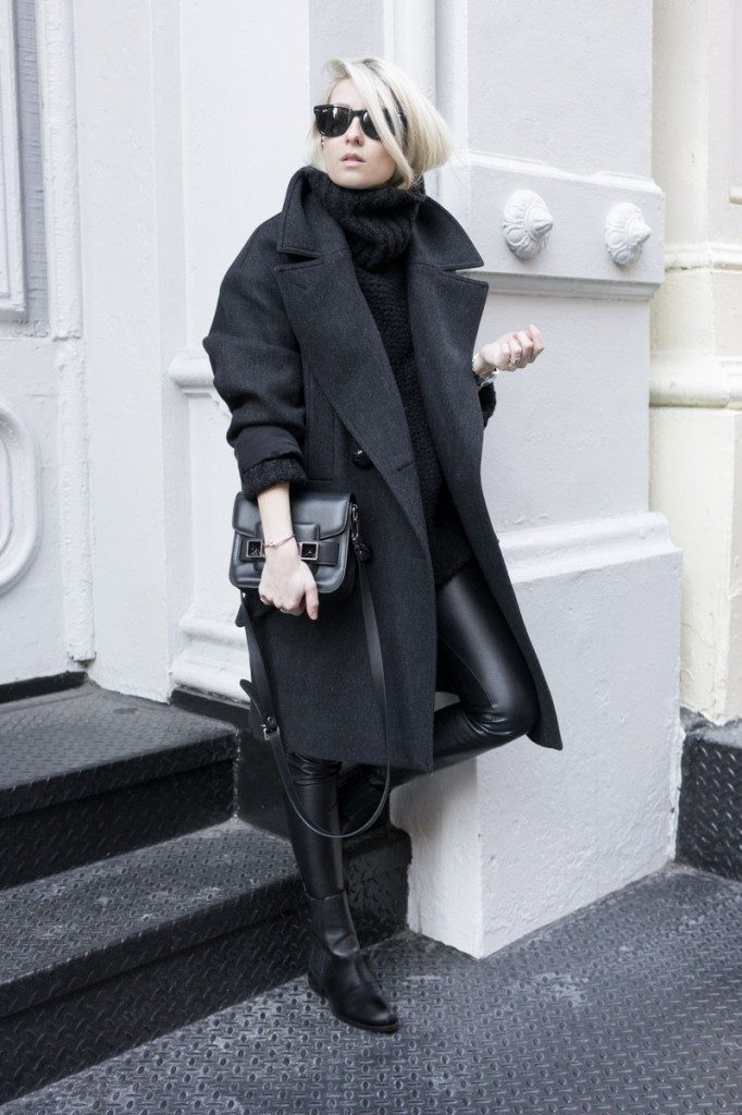 Figtny is wearing a wool coat from Isabel Marant Via H&M, jumper and leggings from Aritzia, ankle boots from Alexander Wang and a tiny bag from Proenza Schouler
