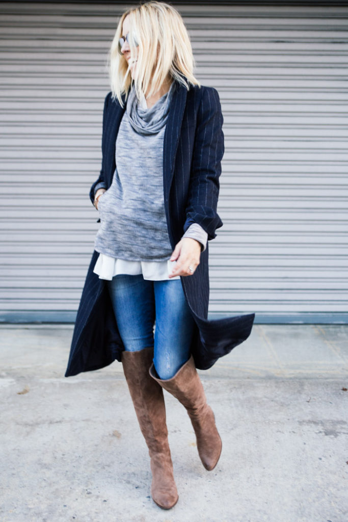Jacey Duprie is wearing a grey striped tunic from Lou &Grey, white silk blouse from Cos, pinstripe coat from Zara and over the knee boots from Dolce Vita