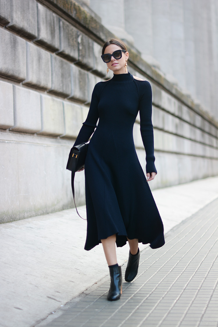 Zina Charkoplia absolutely smashes this gorgeous midi sweater dress. Dress: Celine, Boots: Acne, Sunglasses: Celine, Bag: Saint Laurent.