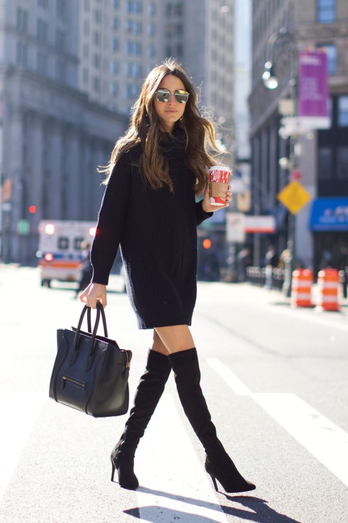 Arielle Nachami couldn't look sleeker, in this all black outfit consisting of a knitted sweater dress, thigh high boots, and a matching leather bag. All you need now is a pair of shades to complete this fabulous style. Dress: Saks Fifth Avenue, Boots: Neiman Marcus.