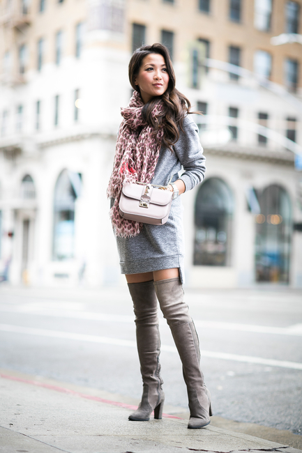 Wendy Nguyen is wearing a pale grey sweater dress from Glamorous
