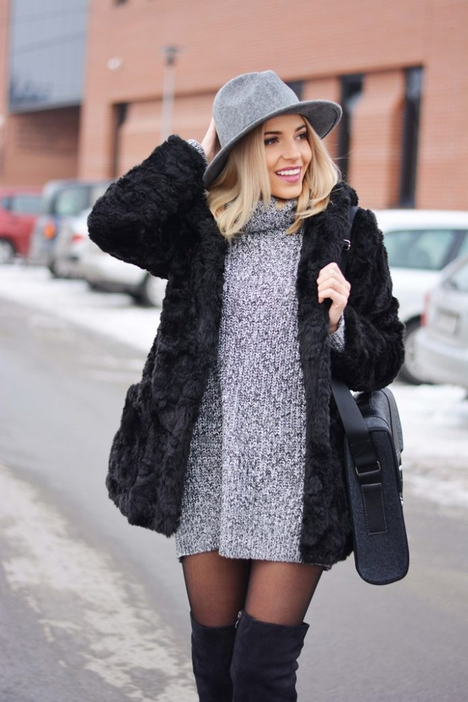 Magda is wearing a grey knit sweater dress from Tally Weijl