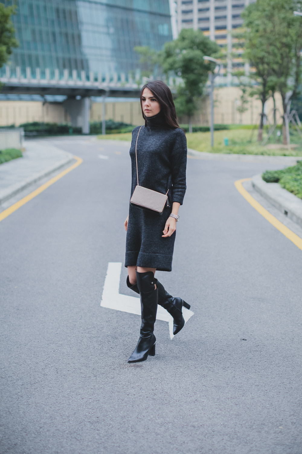 Doina Ciobanu is wearing a charcoal sweater dress from Zara, and the over the knee boots are from Reiss