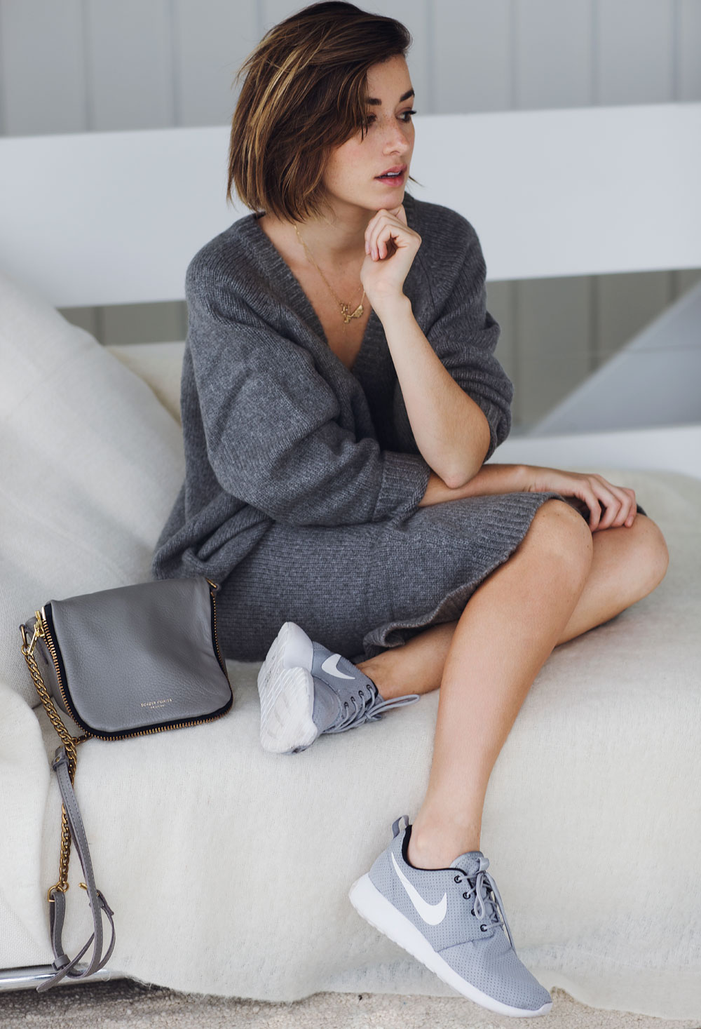 Sweater Dress Trend: Carmen Hamilton is wearing a grey sweater dress from Asos