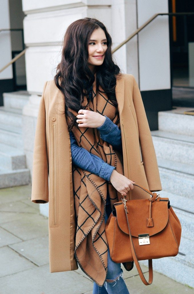 Lolita Masagutova is wearing an oversized black and camel scarf from Asos