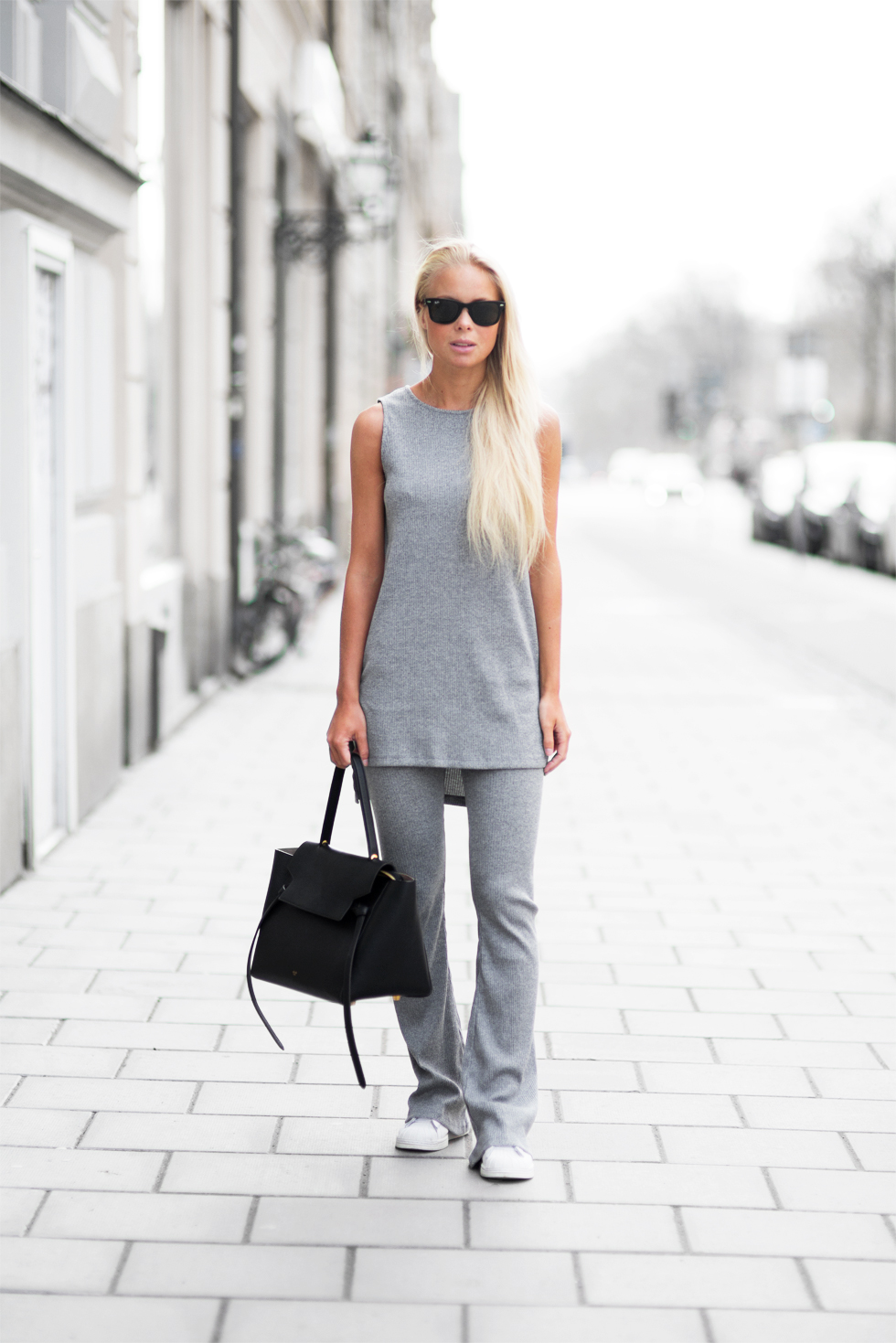 Victoria Tornegren is wearing an all grey outfit, with the trousers and top from Gina Tricot